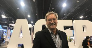 acep 2019 - mark plaster at the acep sign